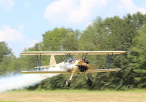 Flight school Stearman Low pass with smoke on